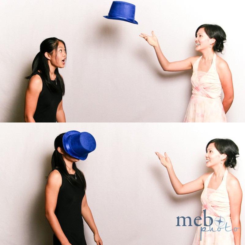 Photo booth challenge: Catch the hat with your head! No, using your face doesn't count!