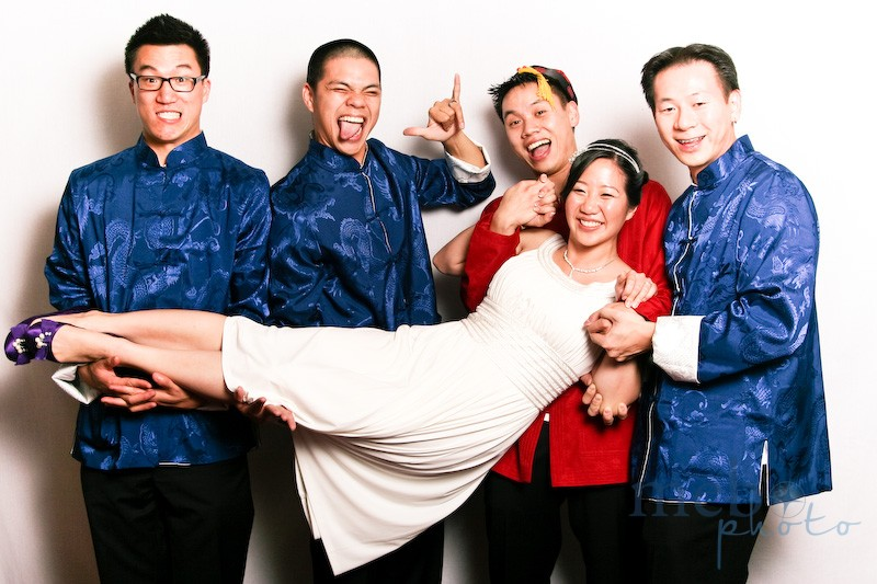 The groomsman in the middle refused to put his left hand under the bride (with good reason!) thus the goofy pose!