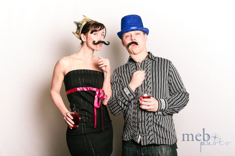 This couple was matching from their pin striped outfits all the way down to their mustaches and drinks!