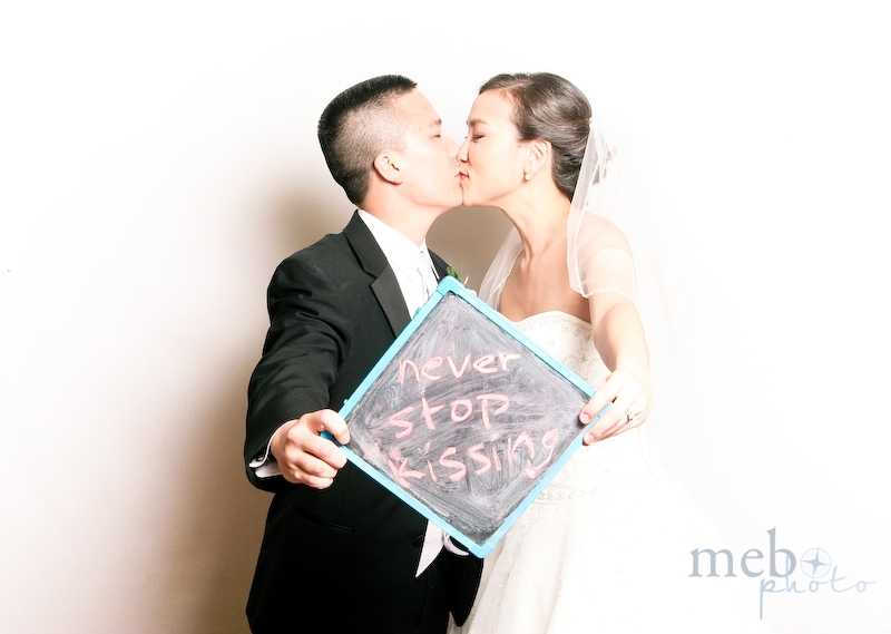"The bride and groom have heeded the wise advice to ""Never Stop Kissing""!"